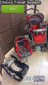 Chico travel system ( stroller & car seat with base ) Doha