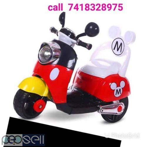 BRAND new kids riding electric scotty bike 0